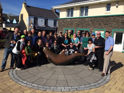 International travelers enjoying the 'Historic Dingle' Walking-Tour. Pictured with our award-winning, 100% Dingle tour-guides at the statue of Fungi the Dolphin, one of the most famous Dolphins in the world! All our tours depart daily from the Fungie statue (beside the Tourist information Office)